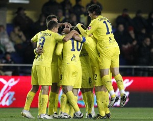 Villarreal's players celebrate after they scored a goal against Real Sociedad during their Spanish first division soccer match in Villarreal